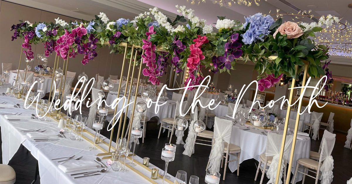 Top table floral decor foliage with hot pink and purple orchids